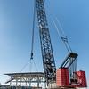 Link-Belt 550 ton, crawler crane maneuvers heliport platform onto 200 X 55 ft barge