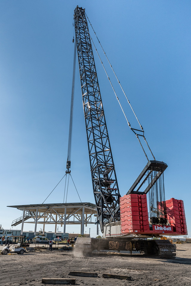 Link-Belt 550 ton, crawler crane maneuvers heliport platform onto 200 X 55 ft barge