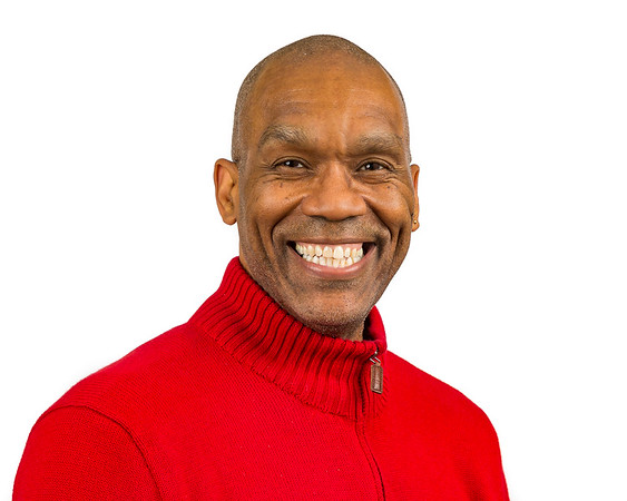 Smiling businessman in orange sweater