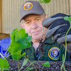 Senior volunteer with seedling