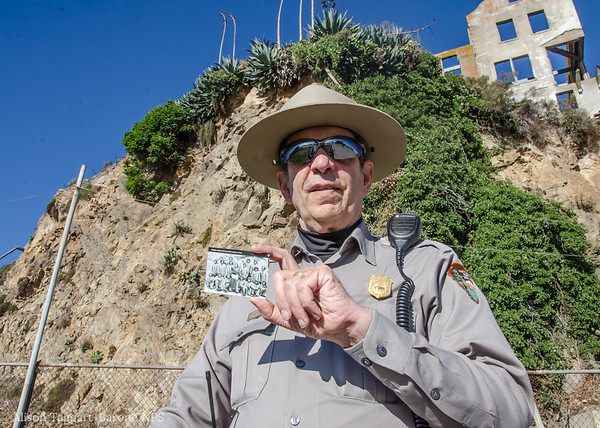 Ranger holding photo of Hopi Indians where it was taken