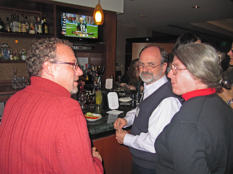 Mark Rhoades, Robert Griffin III (on TV), Charlie Bryant, Mary Norton. Holiday party 2011