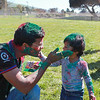 Akhitesh Agrawal celebrating Holi with his son.