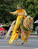 Okie, a 23 year old registered Quarter Horse, loves a parade and being the mount for the Queen in the 30 Years of Aloha Paniolo Parade.