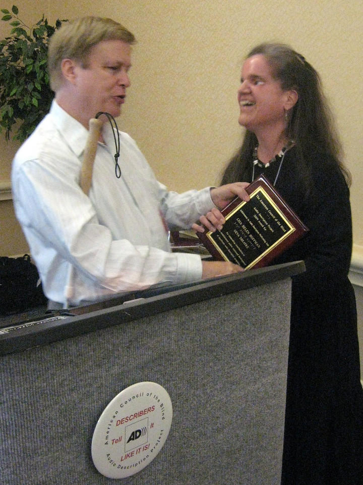 Christopher Gray, Bay Area Digital and immediate past-president, ACB; Lisa Helen Hoffman, freelance description consultant/GeVA Theater accepting Achievement Award in Audio Description-Performing Arts