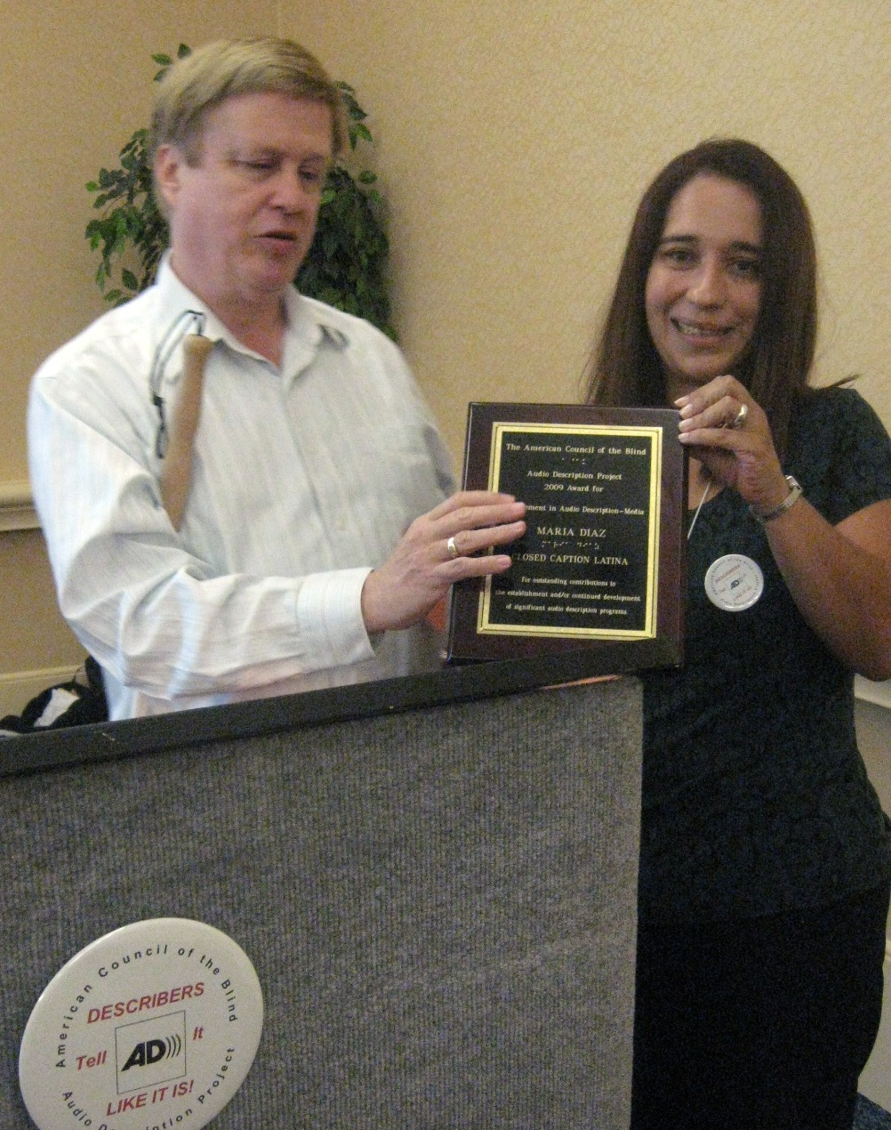 Christopher Gray, Bay Area Digital and immediate past-president, ACB; Maria Diaz, Closed Caption Latina accepting Achievement Award in Audio Description-Media