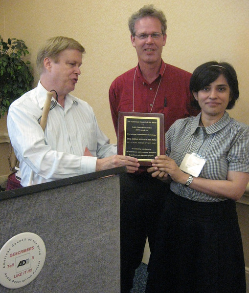 Christopher Gray, Bay Area Digital and immediate past-president, ACB; Ted Armstrong, Royal National Institute of Blind People; Sonali Rai, Royal National Institute of Blind People accepting Achievement Award in Audio Description-International