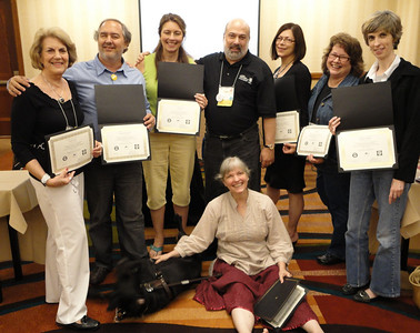 2010 ADP Audio Description Institute graduates:  Ellen LaVan, Dr. Francisco Lima, Linda Bard, (Joel), Jo Lynn Bailey-Page, Lee Brown, Melody Basham, and Cindy Boyle (seated, with Okra, Francisco's service animal)