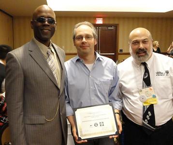 Lynn Manning and Joel Snyder with Bernd Benecke accepting the International Achievement Award in Audio Description
