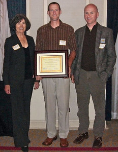 Benicia community development director Charlie Knox holds the Neighborhood Planning Award, flanked by Benicia mayor Elizabeth Patterson and Daniel Parolek, Opticos Design, for the Downtown Benicia Mixed Use Master Plan and Form-Based Code