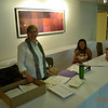 Registration Desk - ready and waiting. Pat Martin and Camila Bareto