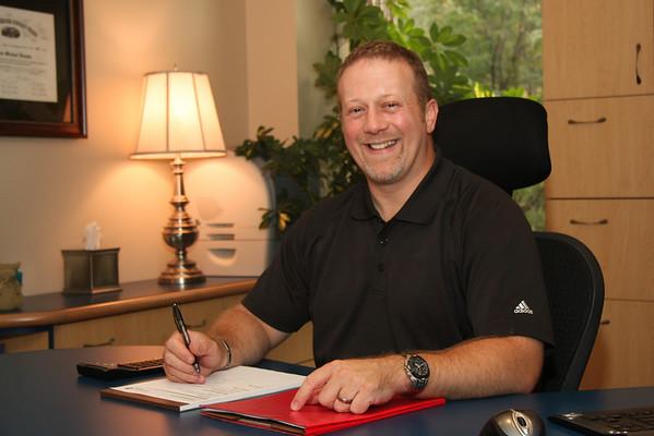 Aaron Vaughn working at his desk, August 2010