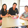 (L->R) Agape Volunteers: PIng Chen & Robert Lee helping Solita Gutinrrez (Extreme R) fill out the patient checkup form