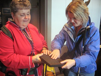 "Marlaina and Jennie examine a ""tea block"" at the ""Russian Bishop's House"""