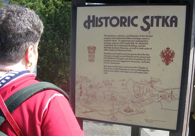 "Marlaina at the ""Historic Sitka"" placard"