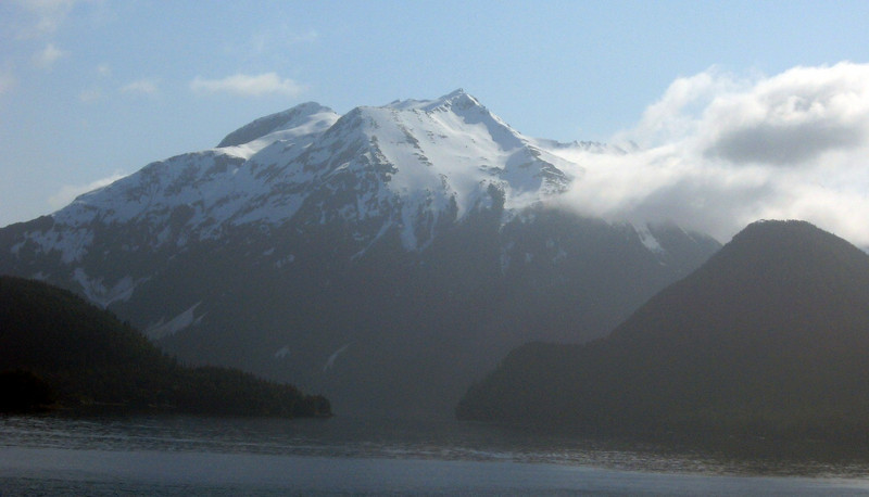 Off the southwest coast of British Columbia-#1:  craggy, snow-capped peaks set against a blue sky