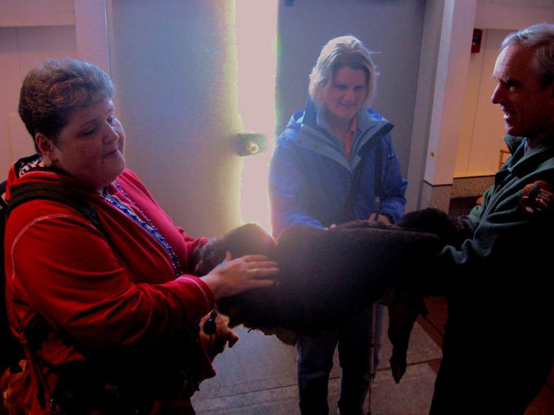 Marlaina and Jennie explore the pelt of a sea otter