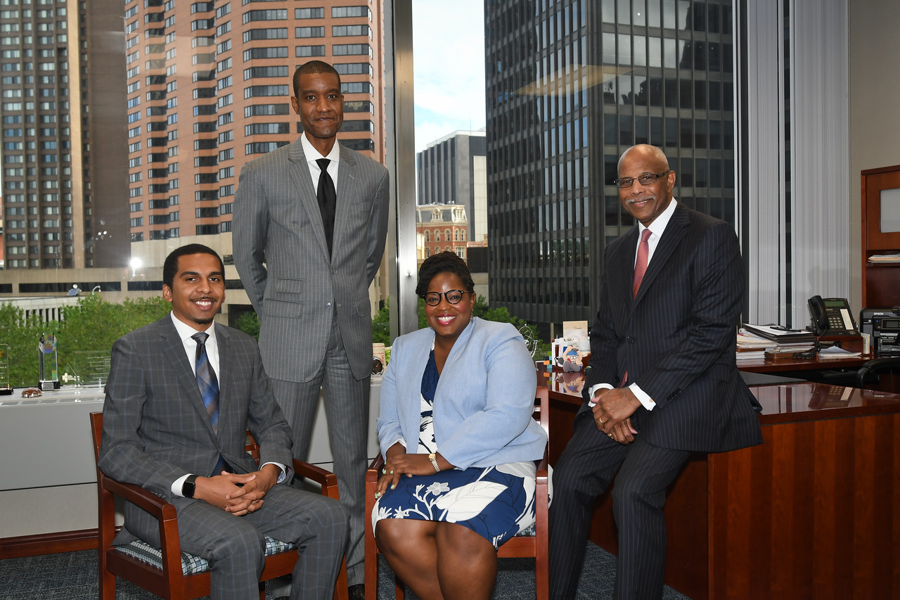 Harbor Bank executives in the Baltimore office on 7-7-17  RED TIE- Joseph Haskins, Jr. Chairman,  President & CEO, Harbor Bankshares Corporation  BLACK TIE- John D. Lewis, EVP, Chief Administrative Officer, Harbor Bankshares Corporation BLUE SWEATER – Tiffany Royster, Vice President, Harbor Bankshares Corporation BLUE TIE- Calvin Allen Young, Vice President, Harbor Bankshares Corporation Photo:  Eric Stocklin