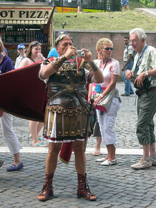 Outside the Colosseum--it's tourist time!  (Is that Caesar?!?  How times have changed ...)