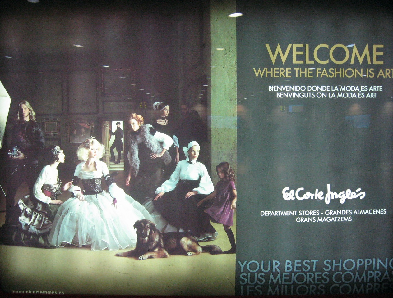 """We're """"welcomed"""" to Spain by an airport poster using Velasquez' """"Las Meninas"""" to advertise a department store ... our sweet daughter Emerie has been enamored of this work for many years."""