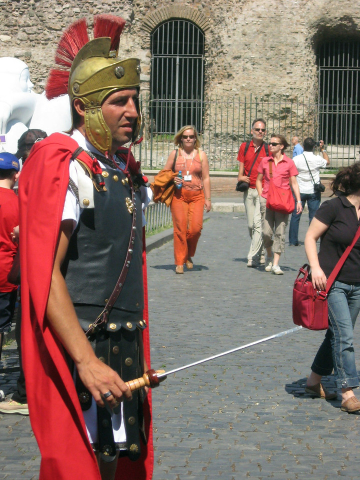 Outside the Colosseum--it's tourist time!  (Is he trying to lift that woman's purse?)