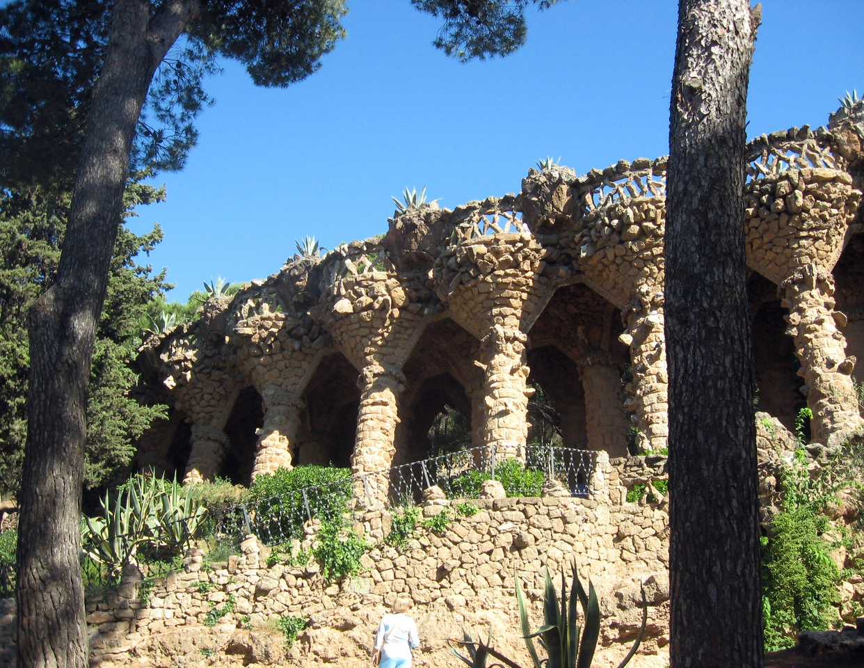"On to Parc Guell (pronounced ""GWAY"")--commissioned by a wealthy industrialist, the plan was to create a garden city but only two houses were ever built.