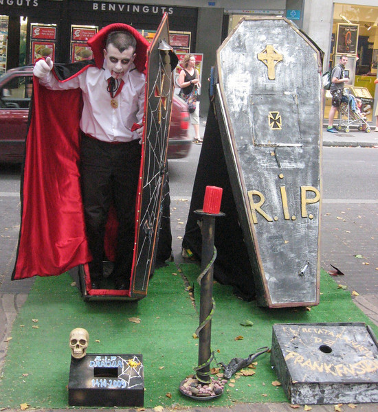 La Rambla performance artist--he only emerges from his coffin when a Euro is dropped in his box.