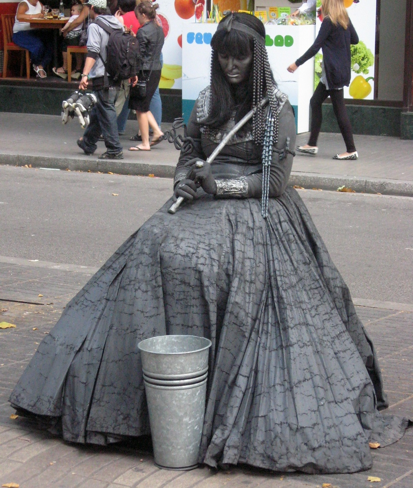 """Speaking of """"art"""" on La Rambla, a unique feature of the grand promenade is the predominance of costumed and painted individuals who pose (usually unmoving, until a coin graces his/her cup).  Here is a gallery of the best of the lot--"""