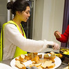 Jennifer Tran (On of the volunteers @ the kitchen area) handing out Breakfast.