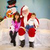 Isabella & Roman Quintero (Children of Juan Quintero) strike a pose with Santa.