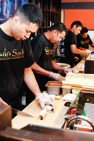 Chef Yosoke Kyutoku preparing a California Roll. (L->R): Yosoke Kyutoku, Eric Presq, Kenny, Alesandro Valdez