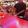 Dan Clarke @ the bar, mixing a long island iced tea.
