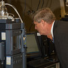 Sec. Tom Vilsack inspects one of the state-of-the-art High Performance Liquid Chromatography instruments in GIPSA's Analytical Chemistry Branch laboratories on October 23, 2013.  USDA photo by David Funk.