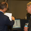 Dr. Tim Norden, Chief of GIPSA's Analytical Chemistry Branch, explains to Sec. Tom Vilsack the assesment and reporting of pesiticide residues in U.S. grain shipments on October 23, 2013.  GIPSA's annual surveys of representative grain lots establish confidence in the safety of the domestic grain supply and our export grain shipments. USDA photo by David Funk.
