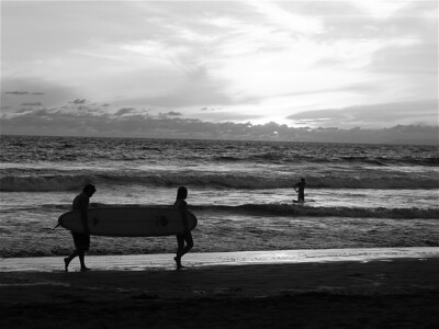 Down in Jaco Beach, Costa Rica.  The sun was setting and the surfers were coming in from the afternoon high tide.