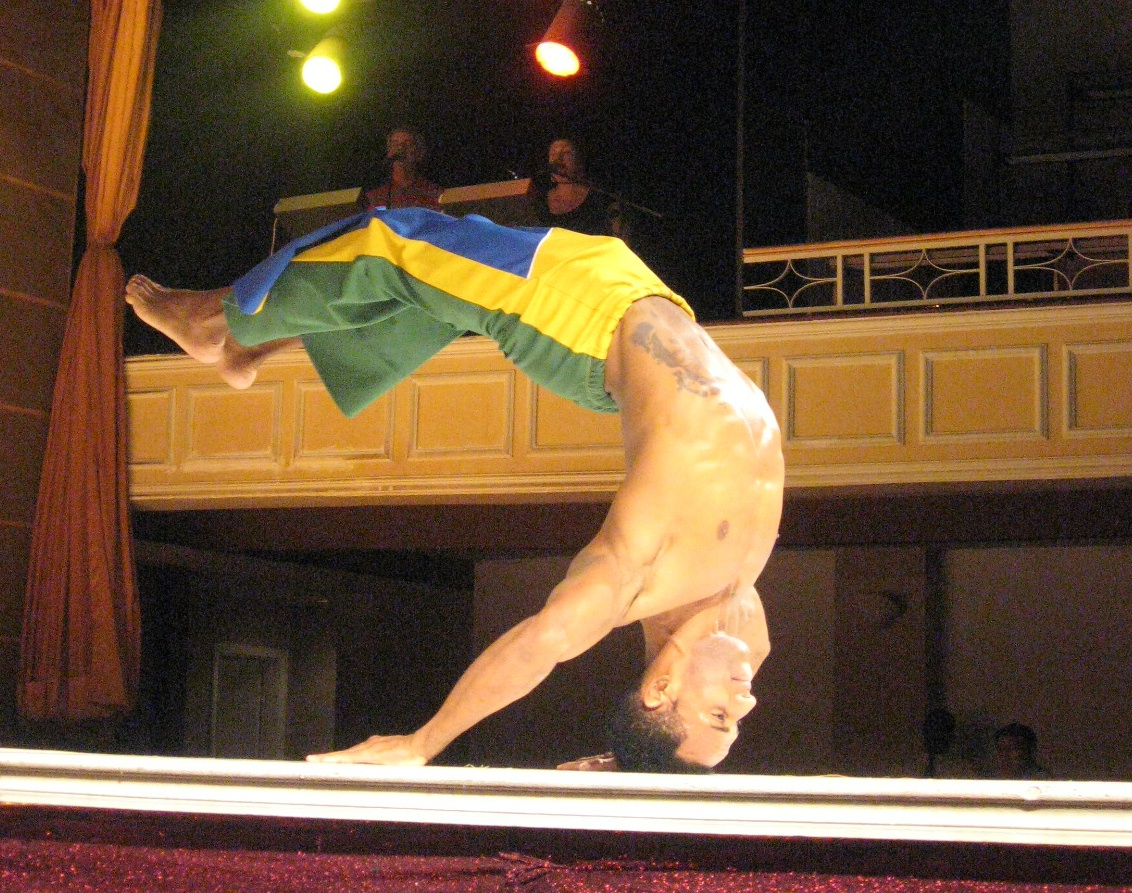 ... and the boys with capoeira-like gymnastics.