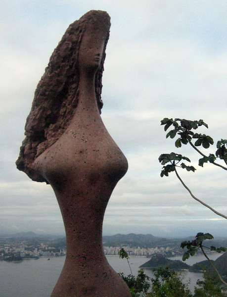"""Atop Sugar Loaf, a sculptural view of the scene:  """"Rio--Mythological Guanabara"""" by Remo Bernucci   """"The skirt--the waves of the sea; The curved waist--the beaches; The breasts--the mountains; The hair--the forests; The silhouette--the gracefulness of the carioca woman; And at the foot of the statue the ibis."""""""