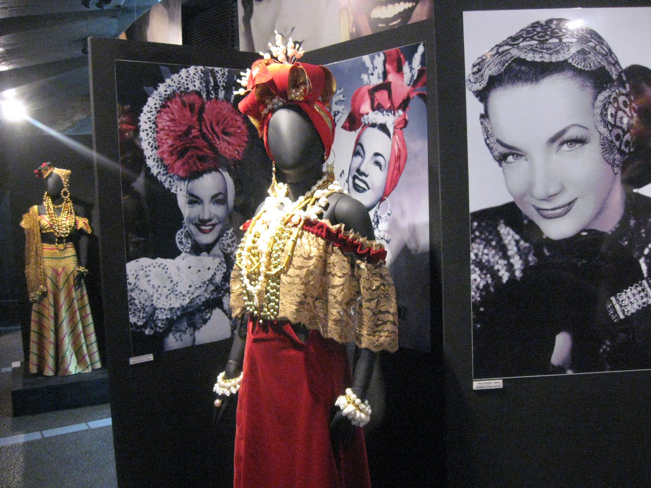 One of Miranda's outfits on display surrounded by black-and-white photos of the star.