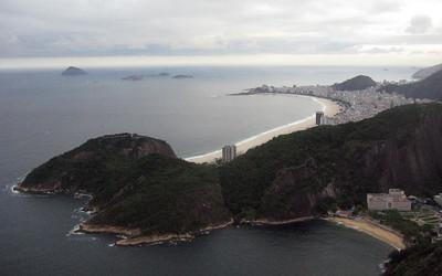 At the summit, facing the curving beach at Copacabana.