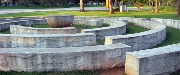 An intersecting spiral of curved, concrete blocks.