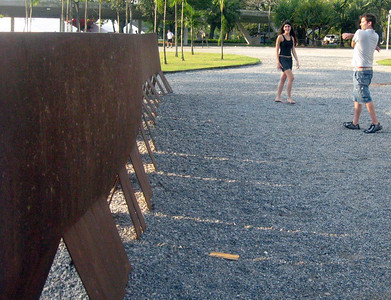 A sculpture garden--Jardim de Esculturas--graces the Parque in the area around the Museu de Arte Moderna (MAM).   Young people enjoy tossing balls and stones off this steel wall installation.