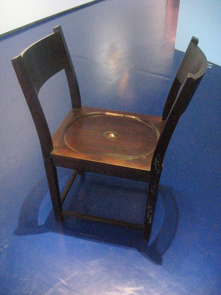 A chair with two backs--or a chair with no back.