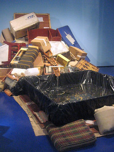 A jumble of furniture and boxes--and a waterfall within.