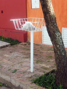 In the neighborhood--pedestal for deposit of bagged garbage.