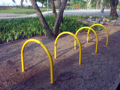 Arcs of yellow metal--*actual* bike racks!  Hmmm--where's the art here?!