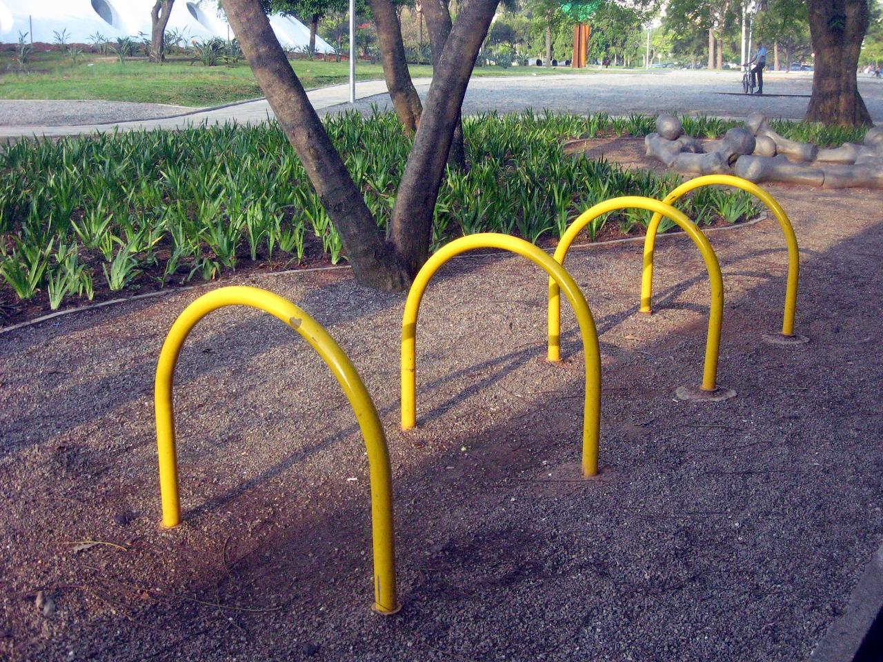 Arcs of yellow metal--*actual* bike racks!  Hmmm--where's the art here?!