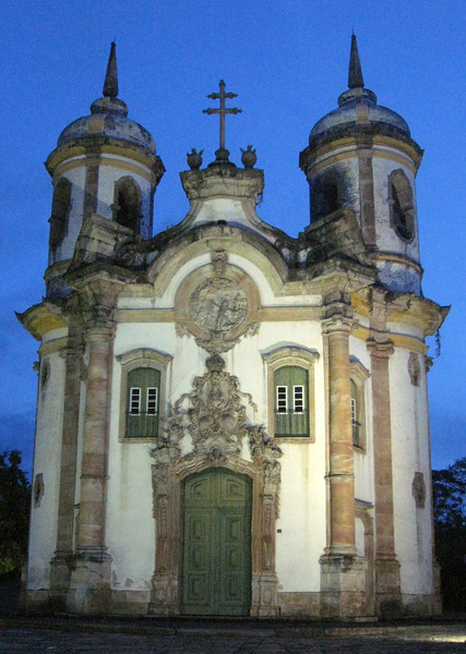"""Igreja de Sao Francisco de Assis--one of South America's most representative Rococo buildings.  Statues in the building were carved by Aleijadinho (1738-1815) meaning """"Little Cripple.""""  The famed sculptor had leprosy and mid-way through his career he could no longer walk and had completely lost the use of his hands--students carried him up hills and strapped hammers and chisels to his arms."""