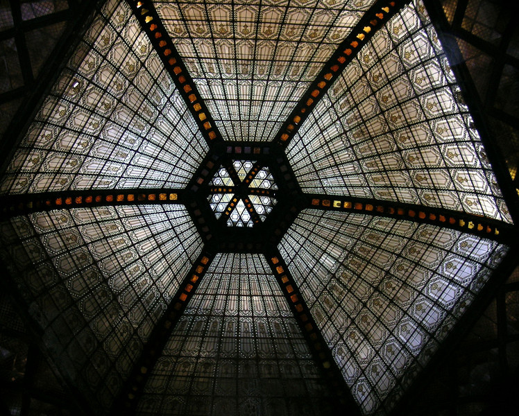 Stained glass ceiling over a pedestrian walkway