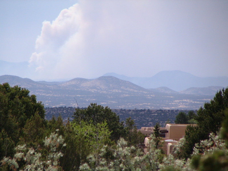 The Las Conchas fire is clearly visible along with pyrocumulus ash clouds to the west of Santa Fe.