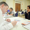 Genamarie Toledo, 13, and eighth grader at the Samoset Middle School in Leominster works with Jason Temple on her budget at the CU4 Reality event on Tuesday at the DoubleTree by Hilton in Leominster. A collaboration of credit unions have spent the school year working with Fitchburg, Leominster, Ayer and Clinton schools on a budgeting program based on career choices. On Tuesday they held an event for the students to put what they learned to uses and see if they could live on a budget. SENTINEL & ENTERPRISE/JOHN LOVE